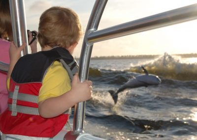 boy_with_great_dolphin_view
